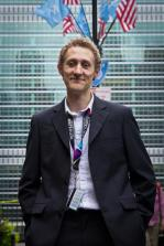 Joe Mitchell in front of the UN Secretariat building in New York