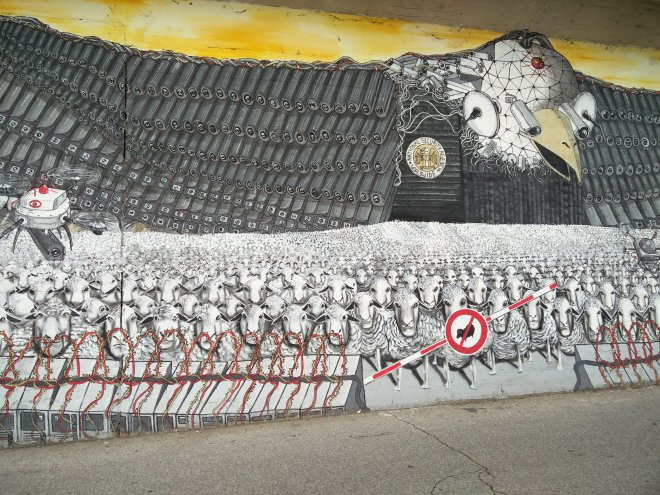 A giant NSA/CIA eagle, complete with drones, watches over the Sheeple. (Ehrenfeld, Köln)